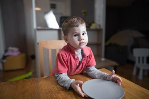Boy-with-empty-plate.jpg